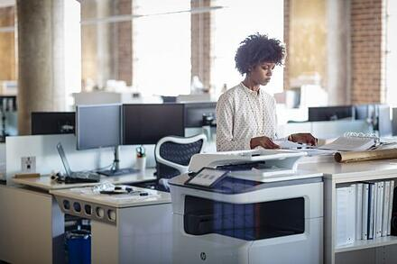 Woman-in-office-using-an-HP-PageWide-Managed-P77750z-2