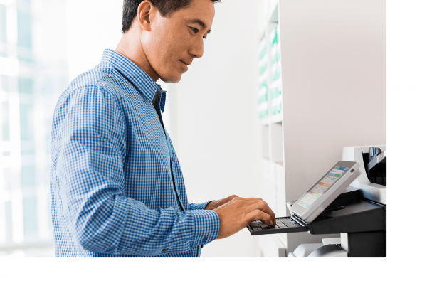 person using hp mfp to assist with digital transformation