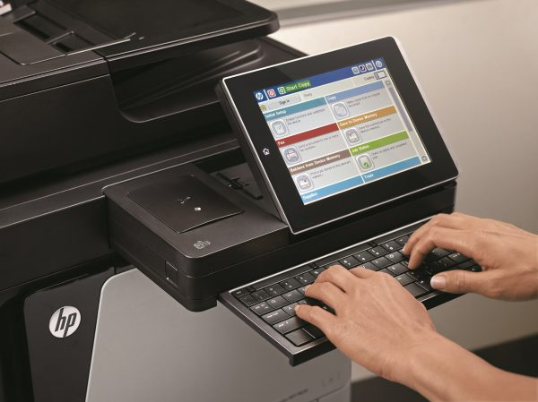 User at an HP Flow MFP