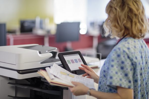 nurse using an hp mfp in an optimized healthcare print environment