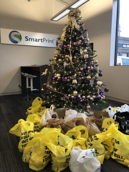 grocery bags under the smartprint christmas tree for the winter food drive